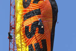 """Greenpeace protesters unfurl a banner that reads """"Resist"""" at the construction site of the former Washington Post building in Washington, Wednesday, Jan. 25, 2017, after police say protesters climbed a crane at the site refusing to allow workers to work in the area.  (AP Photo/Alex Brandon)"""