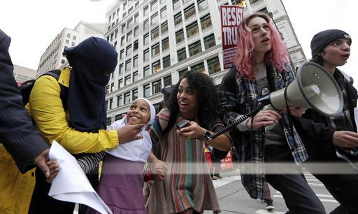 Protesters socialize during Friday's inauguration of Donald Trump. (AP/Elaine Thompson)