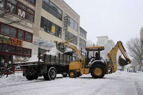 Snow storm moves out of Mid-Atlantic, but cold will linger