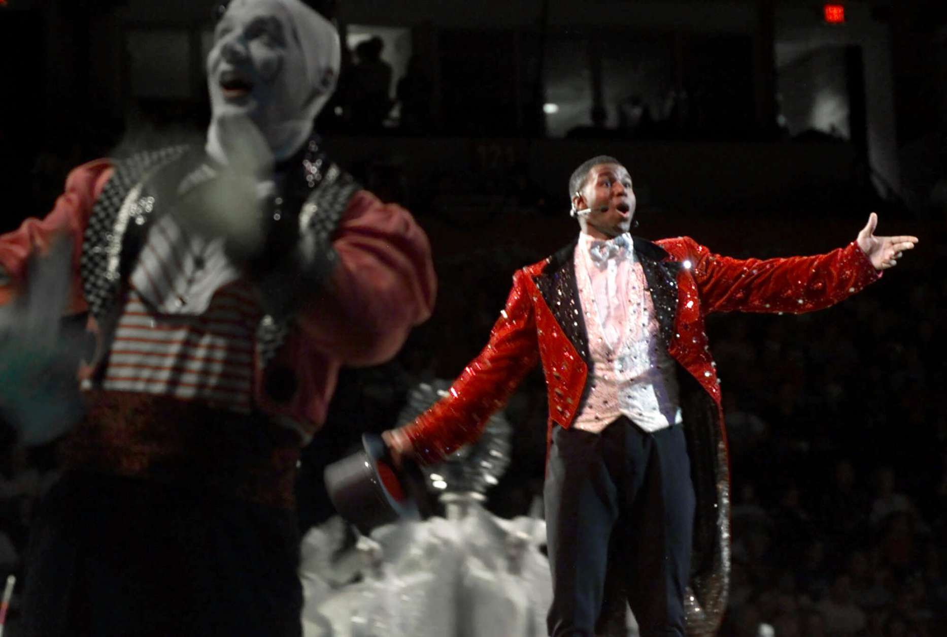 Ringmaster Johnathan Lee Iverson, right, performs during the opening of the Ringling Bros. and Barnum & Bailey circus Wednesday, June 14, 2000, in North Little Rock, Ark. Iverson, 24, is the youngest ringmaster ever for the circus. (AP Photo/Danny Johnston)