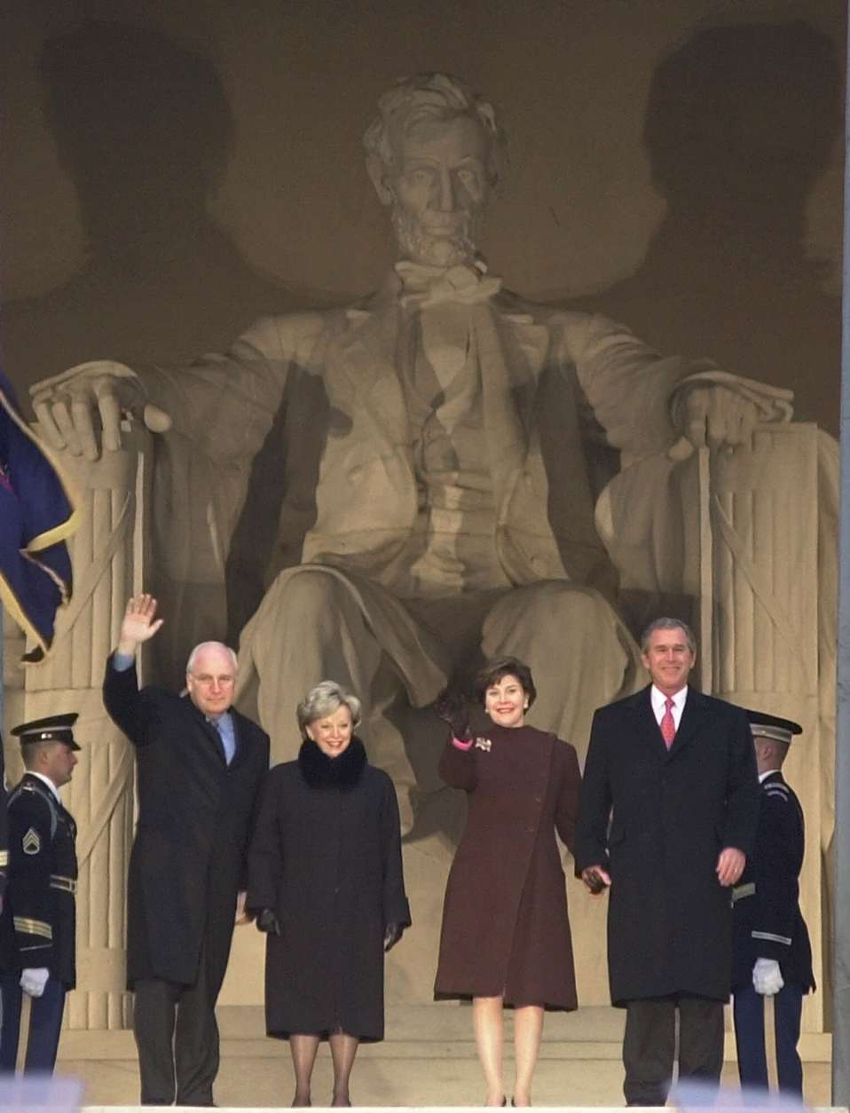 President-elect Bush, right, with wife Laura, and Vice President-elect Dick Cheney and wife Lynne are introduced at the Presidential Inaugural Opening Celebration at the Lincoln Memorial in Washington, Thursday, Jan. 18, 2001. (AP Photo/Charles Rex Arbogast)