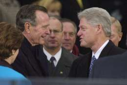President Clinton is greeted by former President George Bush as he arrives at the U.S. Capitol for inauguration ceremonies Saturday, Jan. 20, 2001, in Washington. (AP Photo/Ron Edmonds)