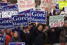 Gore supporters line the parade route along Pennsylvania Avenue in Washington Saturday, Jan. 20, 2001, as the presidential inaugural parade works its way from the Capitol to the White House. (AP Photo/J. Scott Applewhite)
