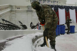A member of the Navy Seabees shovels snow from in front of the Capitol, Wednesday, Jan. 19, 2005 as preparations continue for Thursday's swearing in of  President Bush. (AP Photo/Charles Dharapak),