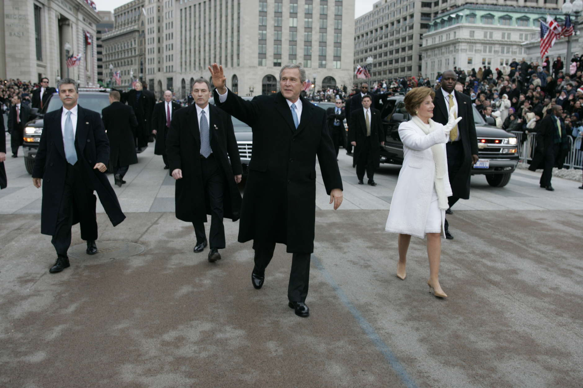 President Bush and first lady Laura Bush walk during the inauguration parade in front of the White House. Thursday, Jan. 20, 2005, in Washington. (AP Photo/Doug Mills/Pool)