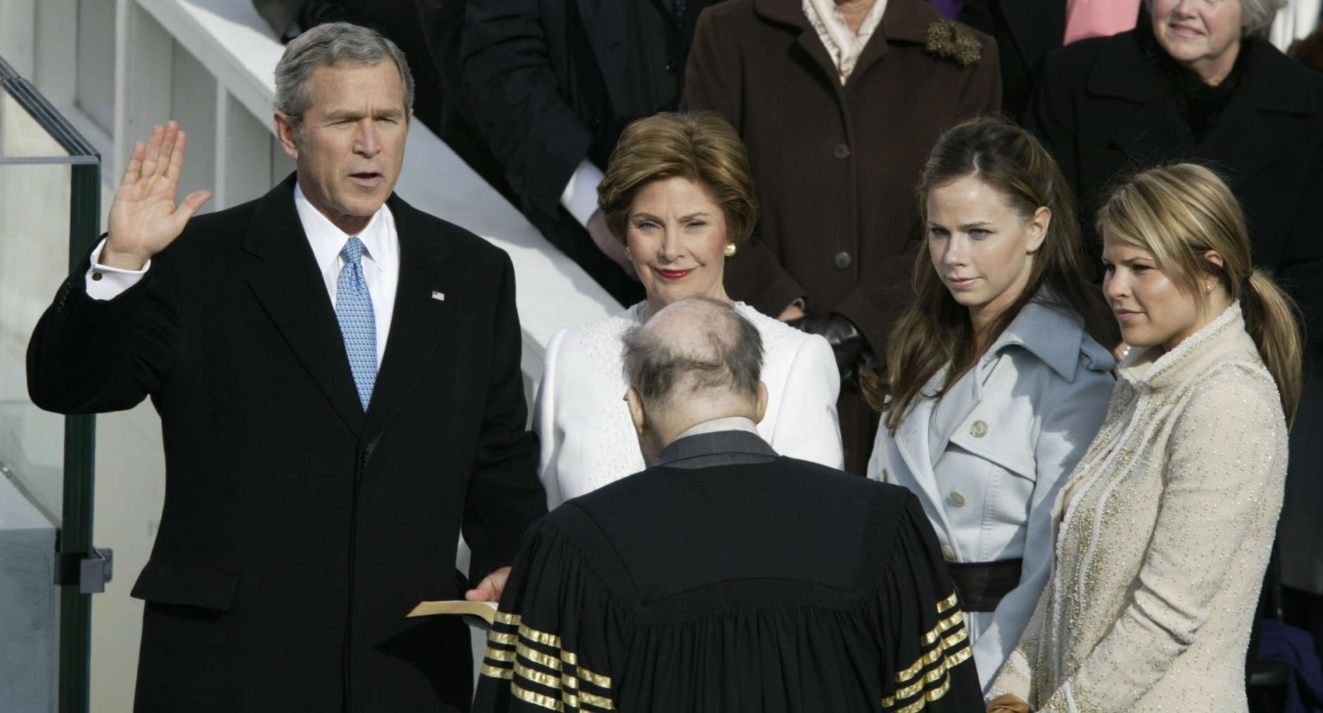President Bush is sworn in by Chief Justice William Rehnquist during his inauguration on Capitol Hill Thursday, Jan.20, 2005. First lady Laura Bush holds the bible as daughters, Jenna, right, and Barbara look on. (AP Photo/Stephan Savoia)