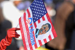 A spectator in the crowd waves a souvenir Barack Obama flag prior to the Presidential Inauguration in Washington, Tuesday, Jan. 20, 2009.   (AP Photo/Evan Agostini)