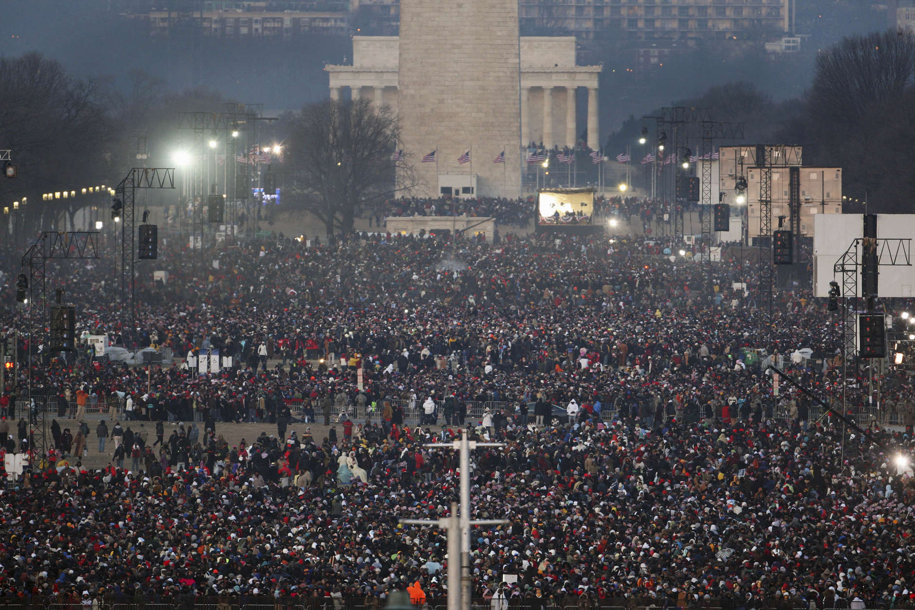 Crowds gather early on the National Mall for the swearing-in ceremony for President-elect Barack Obama in Washington, Tuesday, Jan. 20, 2009.  (AP Photo/Ron Edmonds)