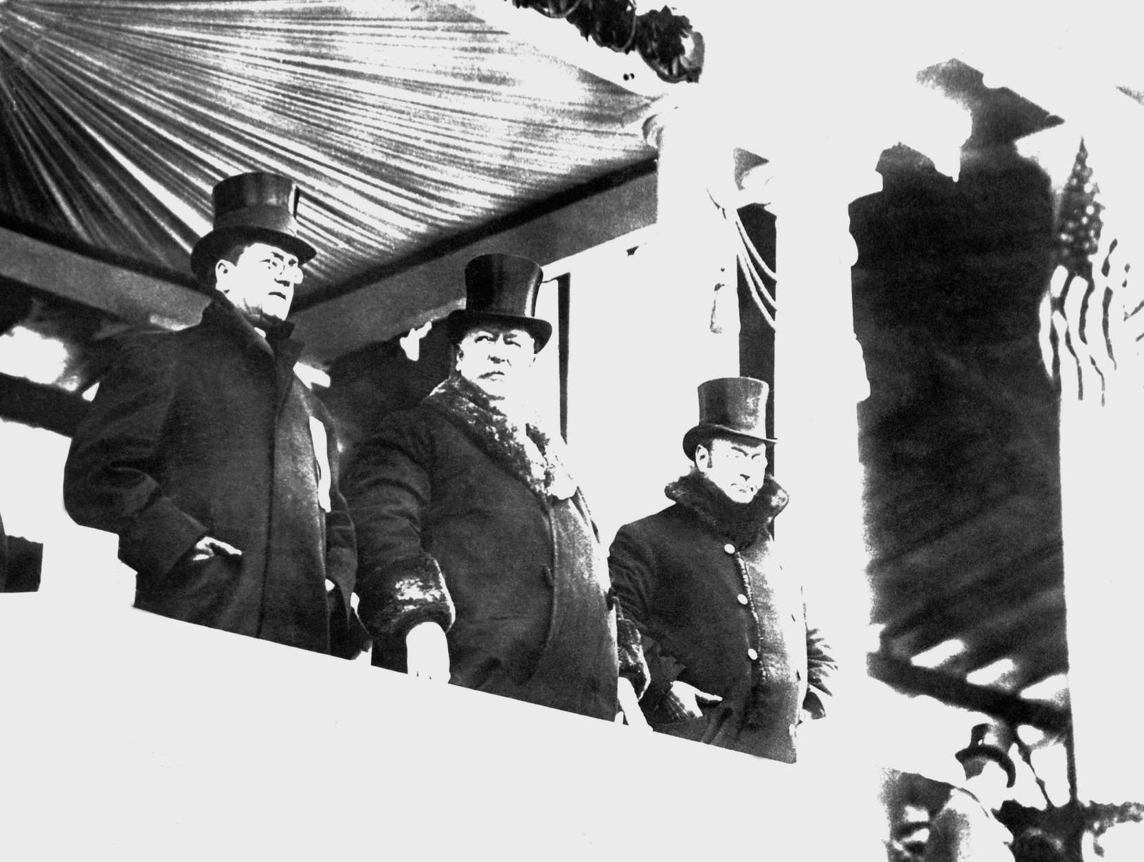 William Howard Taft, center, wore a big fur-lined overcoat when he reviewed parade after his inauguration as president, on March 4, 1909 in Washington.  At right is James S. Sherman, vice president of the United States, and at left Edward Hallwagon, chief of the Inaugural Committee.    A whirling blizzard, featured by flashes of lighting, as well as rain, snow and a cutting wind, made it one of the roughest of all inauguration days. (AP Photo)