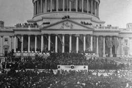 President William Howard Taft  sits in a horse draw carriage beside his wife Helen  in front of the white podium area of photo after Inaugural  ceremonies at the Capitol, in center of photo.  The president and his procession are preparing to leave the Capitol area.   The inauguration took place in the Senate chamber because of a blizzard on March 4, 1909.   For the first time in the country's history, the president's wife  accompanied her husband on the return ride in the procession from the Capitol to the White House following his Inauguration.    (AP Photo/Library of Congress)