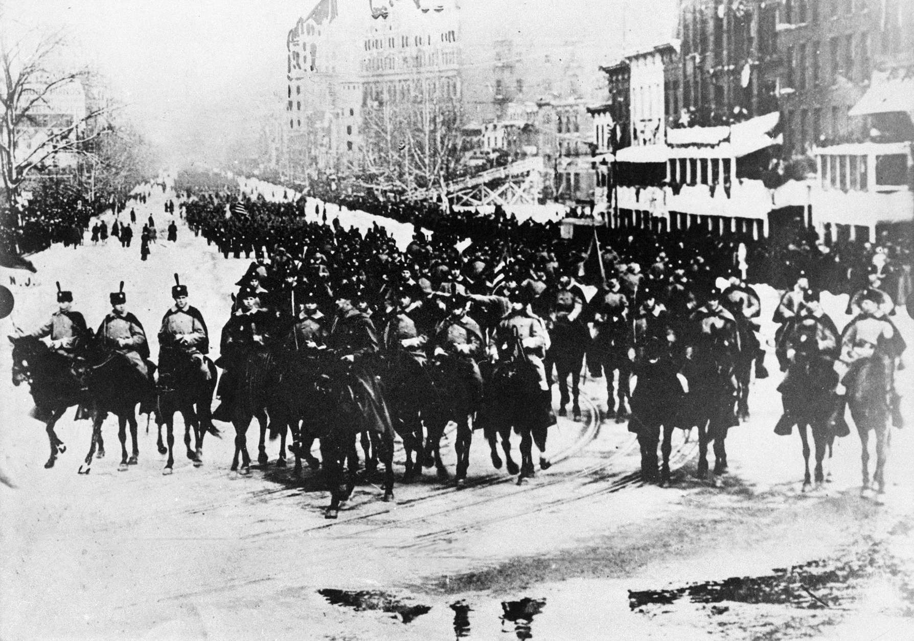 The inaugural parade for U.S. President Woodrow Wilson takes place in Washington, D.C., on Jan. 20, 1913.  (AP Photo)