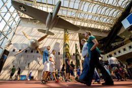 In this photo taken April 19, 2015,  people walk in the Smithsonian National Air and Space Museum in Washington. A record number of U.S. tourists visited Washington last year. The city's tourism bureau, Destination DC, announced Tuesday, May 3, 2016, that the nation's capital welcomed 19.3 million domestic visitors in 2015. That's up one million from the 2014 total, and it shows the continuing strength of Washington's tourism industry after the Great Recession. (AP Photo/Andrew Harnik)