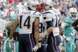 New England Patriots quarterback Tom Brady (12) congratulates wide receiver Michael Floyd (14) after Floyd scored a touchdown, during the first half of an NFL football game against Miami Dolphins, Sunday, Jan. 1, 2017, in Miami Gardens, Fla. (AP Photo/Lynne Sladky)