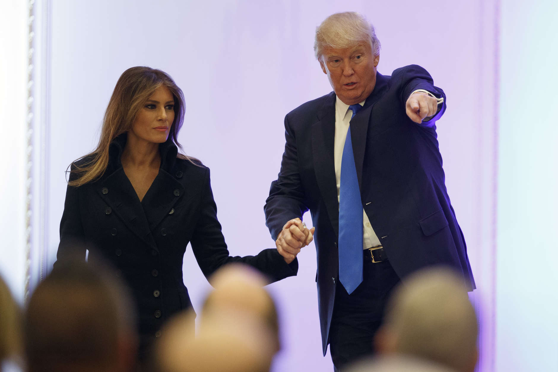 President-elect Donald Trump and his wife Melania arrive to the Leadership Luncheon at Trump International in Washington, Thursday, Jan. 19, 2017. (AP Photo/Evan Vucci)