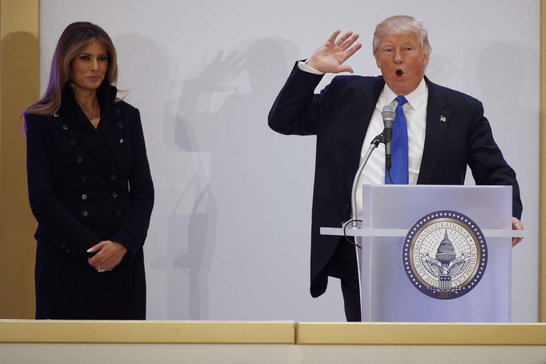 Melania Trump listens as her husband, President-elect Donald Trump speaks during the Leadership Luncheon at Trump International in Washington, Thursday, Jan. 19, 2017. (AP Photo/Evan Vucci)