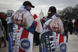 Spectators gather on the National Mall in Washington, Friday, Jan. 20, 2017, before the presidential inauguration of Donald Trump as the 45th president of the United States. (AP Photo/John Minchillo)