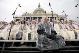 Members of the Mormon Tabernacle Choir sit in the rain waiting for the swearing in of Donald Trump as the 45th president of the United States to begin during the 58th Presidential Inauguration at the U.S. Capitol in Washington. Friday, Jan. 20, 2017 (AP Photo/Carolyn Kaster)