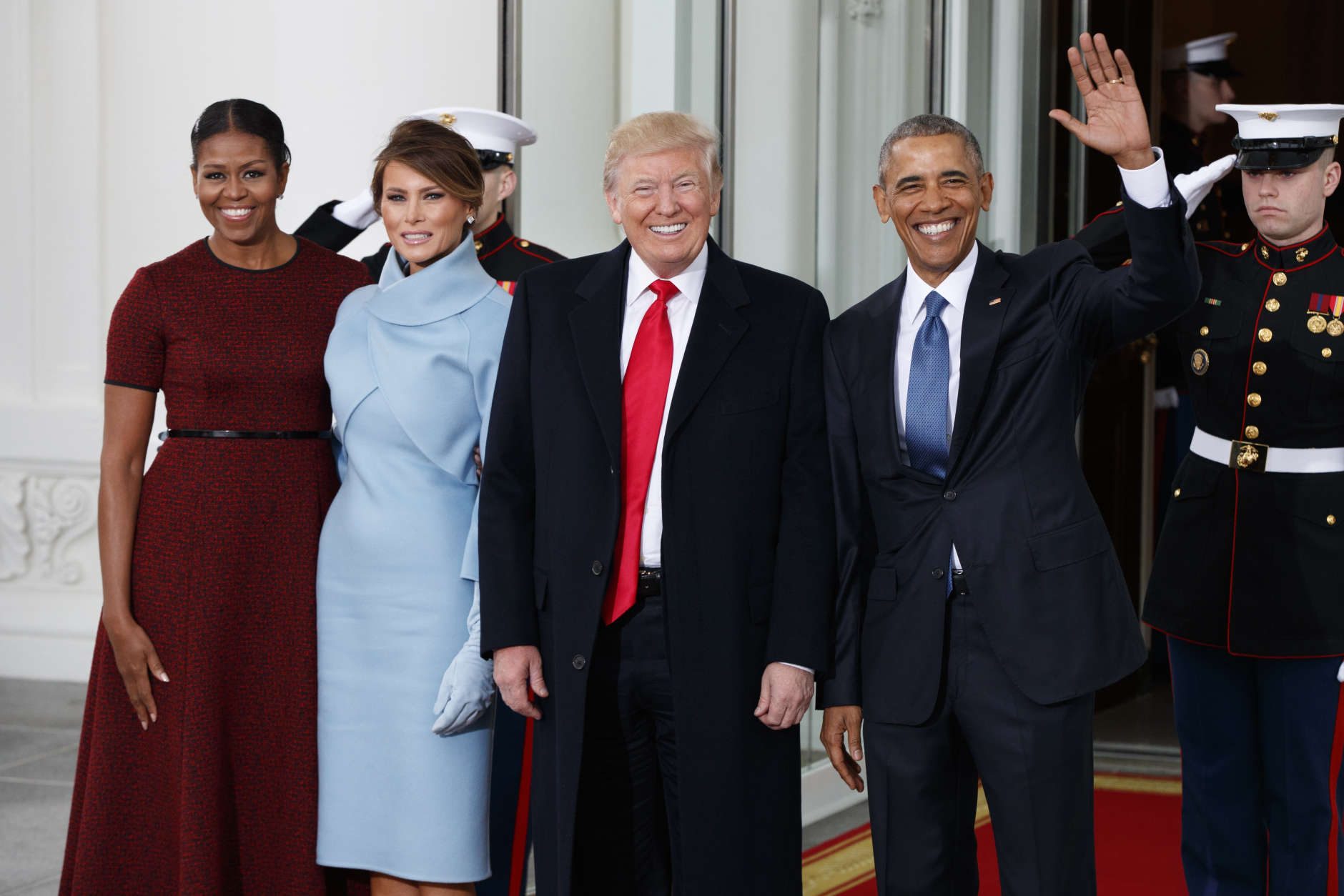 President Barack Obama and first lady Michelle Obama stand with President-elect Donald Trump and his wife Melania Trump at the White House, Friday, Jan. 20, 2017, in Washington. (AP Photo/Evan Vucci)