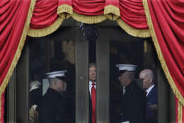 President-elect Donald Trump waits to stop out onto the portico for his Presidential Inauguration at the U.S. Capitol in Washington, Friday, Jan. 20, 2017. (AP Photo/Patrick Semansky)
