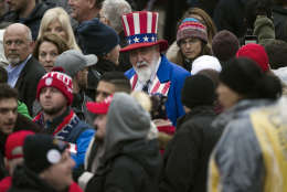 A man dressed as Uncle Sam walks through the crowd as they wait on Pennsylvania Avenue in Washington, Friday, Jan. 20,2017,  for the start of the President Donald Trump's Inaugural Parade. (AP Photo/Cliff Owen)