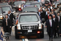 Members of President Donald Trump's Secret Service detail walk with the First Family's motorcade vehicle as they move alone the Inauguration Day Parade Route in Washington, Friday, Jan. 20, 2017, after Donald Trump was sworn in as the 45th president of the United States. (AP Photo/Carolyn Kaster)