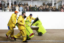 A horse clean up crew passes by the reviewing stand during President Donald Trump's inaugural parade on Pennsylvania Ave. outside the White House in Washington, Friday, Jan. 20, 2017. (AP Photo/Andrew Harnik)