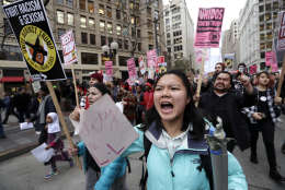 A coalition of students, immigrants, refugees and supporters fill a downtown street as they head to a rally while protesting on Inauguration Day, Friday, Jan. 20, 2017, in Seattle. (AP Photo/Elaine Thompson)