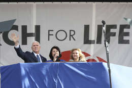 Vice President Mike Pence, left, with his wife Karen Pence, center, wave to the crowd at the March for Life on the National Mall in Washington, Friday, Jan. 27, 2017. (AP Photo/Manuel Balce Ceneta)