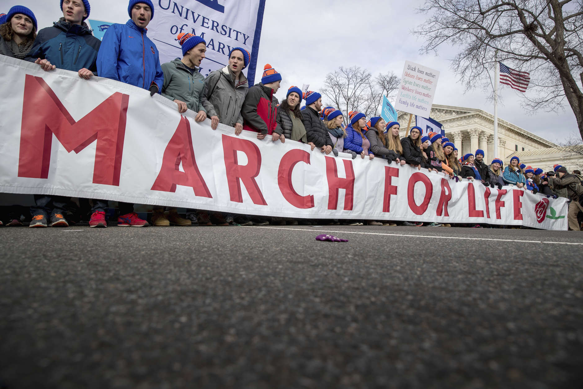 Anti-abortion activists march past the Supreme Court in Washington, Friday, Jan. 27, 2017, during the annual March for Life. Thousands of anti-abortion demonstrators gathered in Washington for an annual march to protest the Supreme Court's landmark 1973 decision that declared a constitutional right to abortion. (AP Photo/Andrew Harnik)