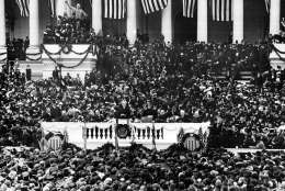 This general view shows the second inauguration of President Woodrow Wilson as he delivers his inaugural address on the East Portico of the Capitol building in Washington, D.C., on March 5, 1917.  (AP Photo)