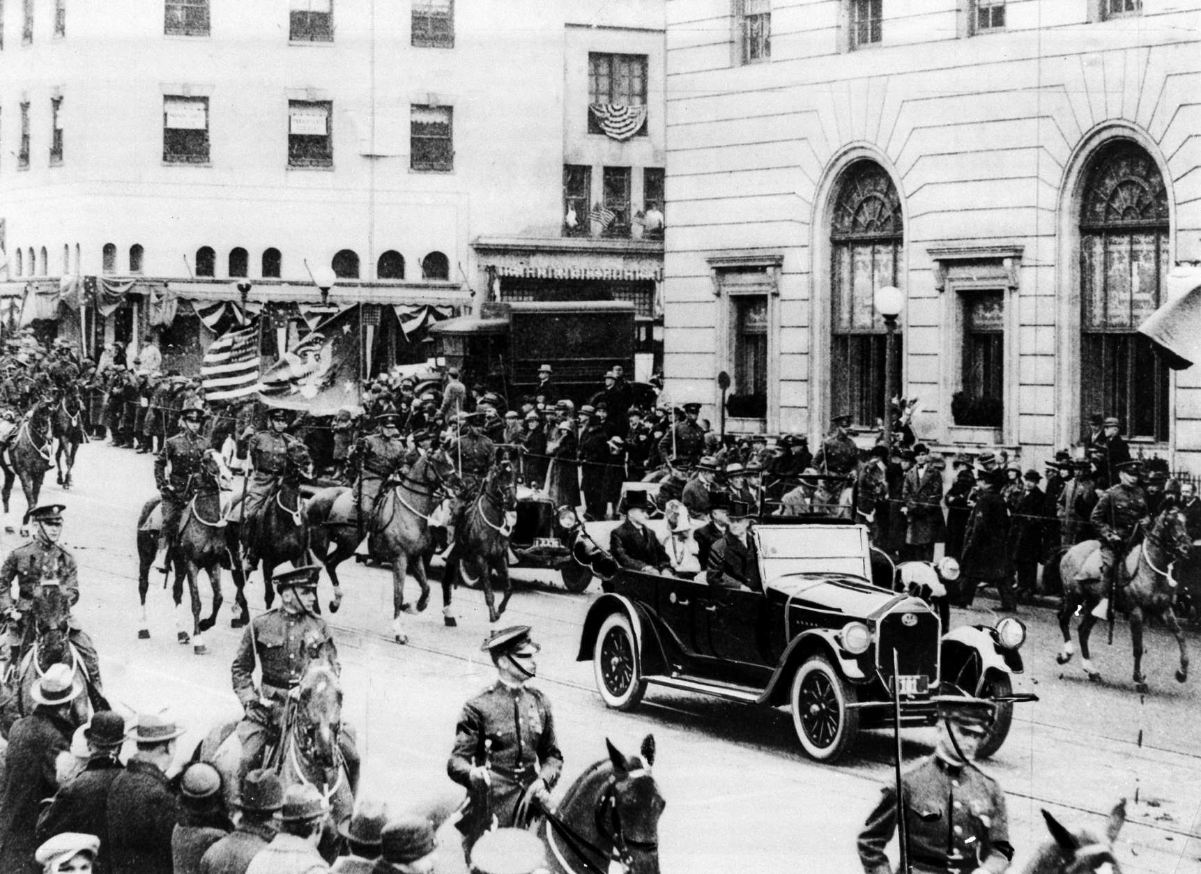 President Calvin Coolidge rides in an open car at the head of the inaugural parade with his wife Grace and Chief Justice Wiliam H. Taft in Washington, D.C., on March 4, 1925.  Coolidge was sworn in as the 30th president of the United States.  (AP Photo)