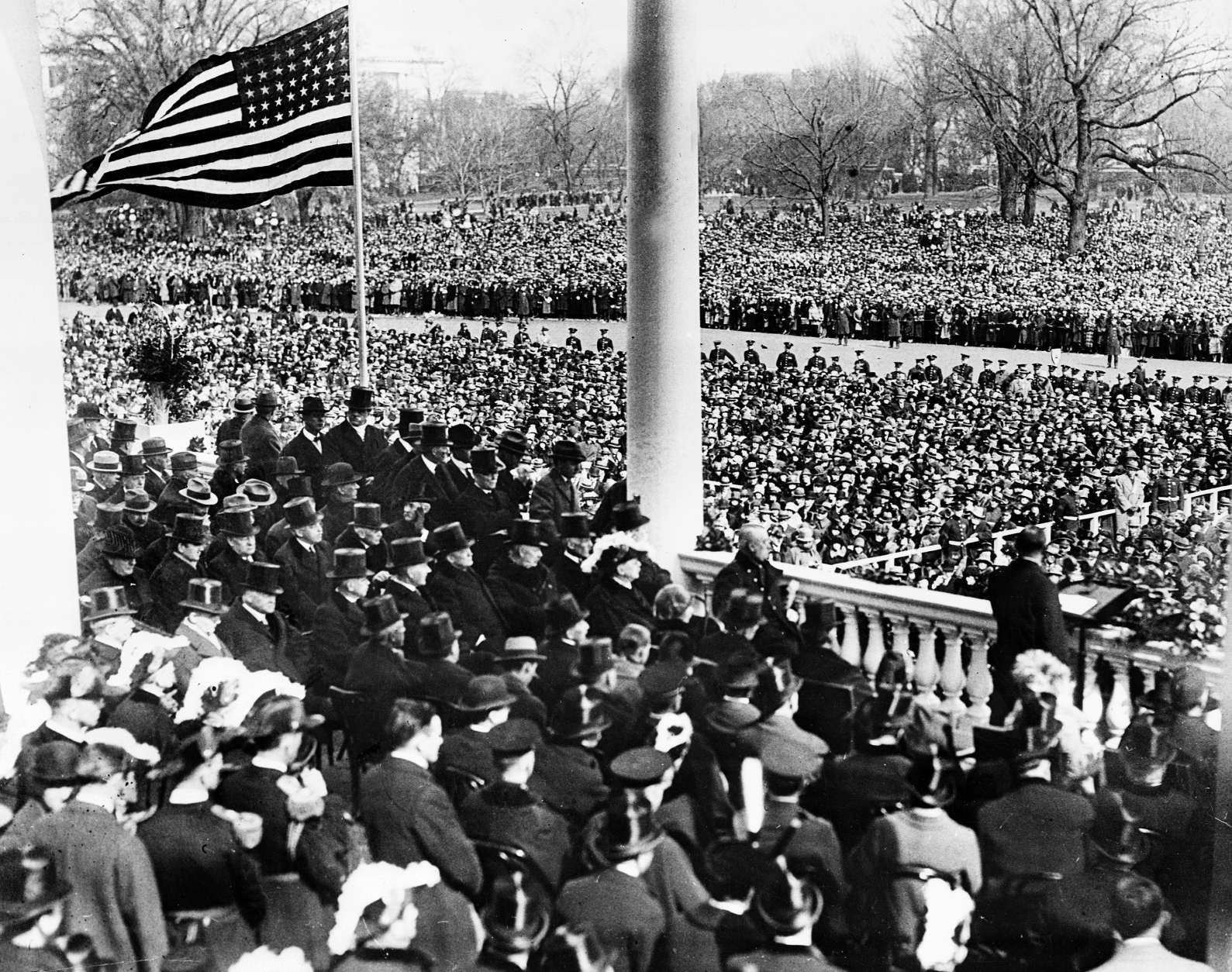 U.S. President Calvin Coolidge, right foreground, delivers his inaugural address after taking the oath of office on the East Portico of the Capitol building in Washington, D.C. on March 4, 1925.  Coolidge was sworn in as the 30th president of the United States.  (AP Photo)