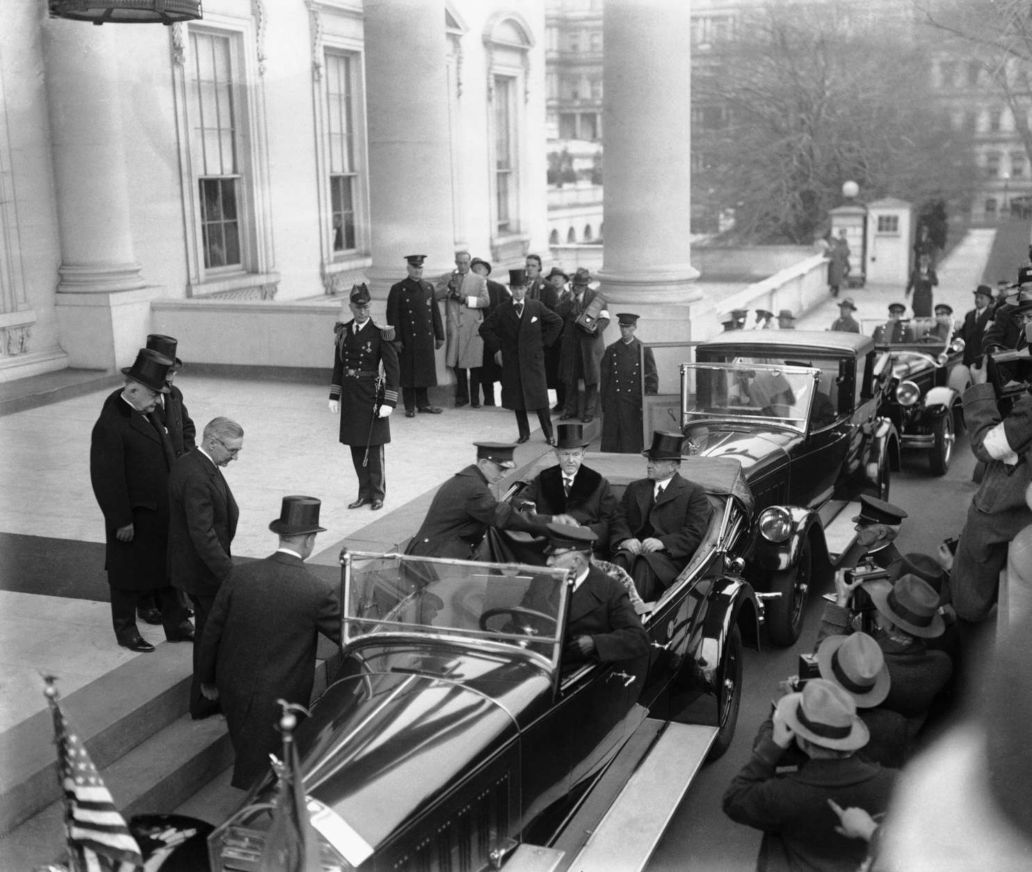 President Calvin Coolidge and President-elect Herbert Hoover, seated in car, are shown as they left the White House for Hoover's inauguration, March 4, 1929.  (AP Photo)