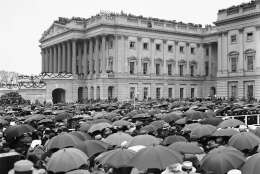 Crowds stand in the rain as they witness the inauguration of Herbert Hoover in Washington, D.C., March 4, 1929.  (AP Photo)