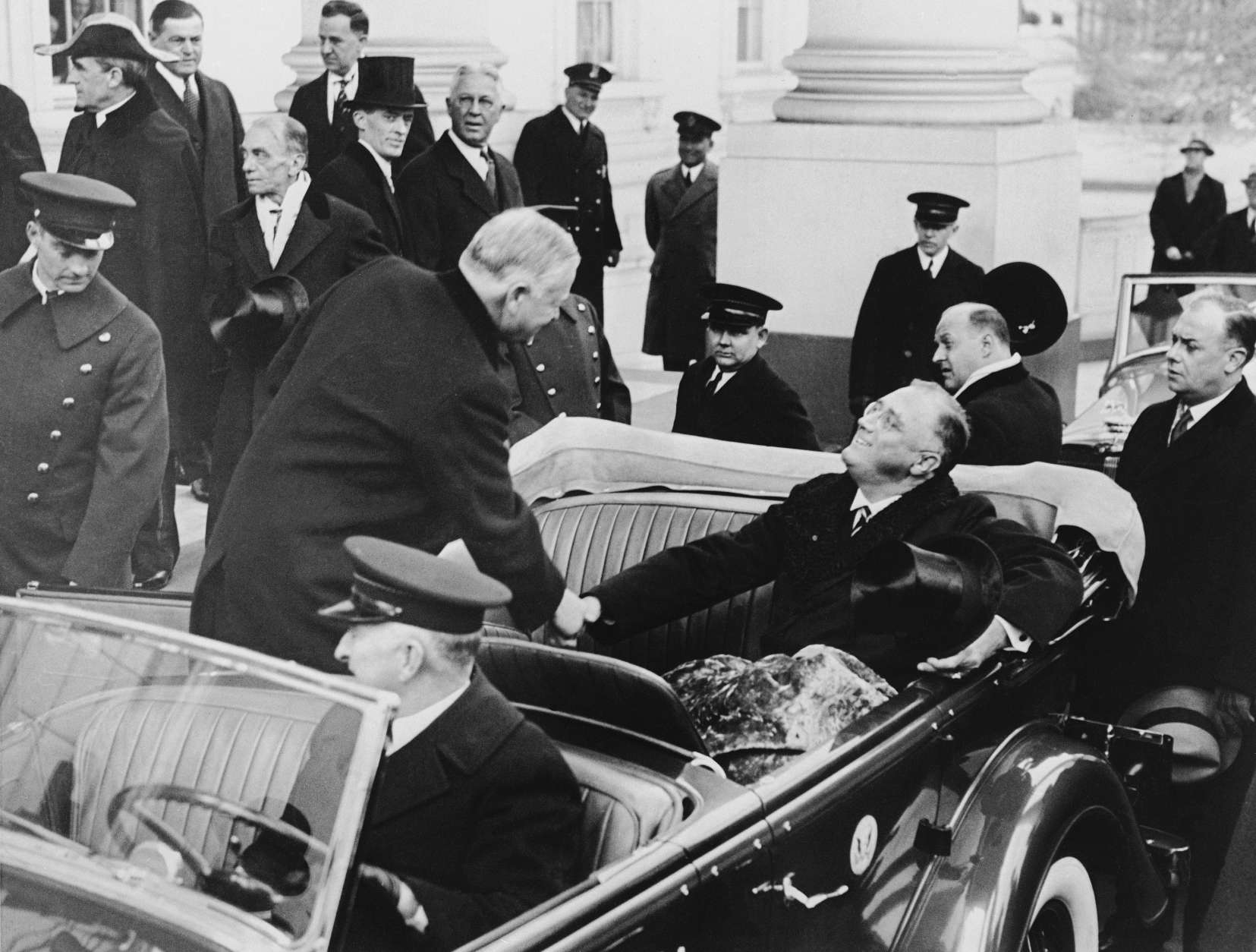 President-elect Franklin D. Roosevelt greets current Pres. Herbert Hoover warmly as the latter steps into the Roosevelt car at the White House for the trip to the Capitol and the inaugural ceremonies in Washington, March 4, 1933.  (AP Photo)