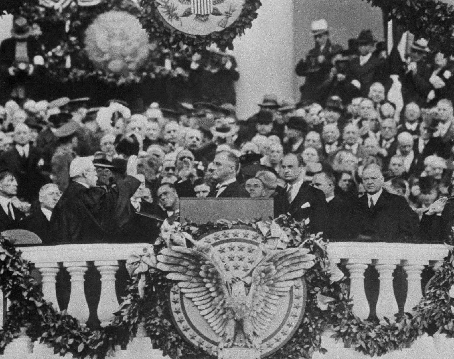 Pres. Franklin D. Roosevelt, center, shown being sworn in, March 4, 1933, Washington, D.C. The rest of the group is unidentified. (AP Photo)