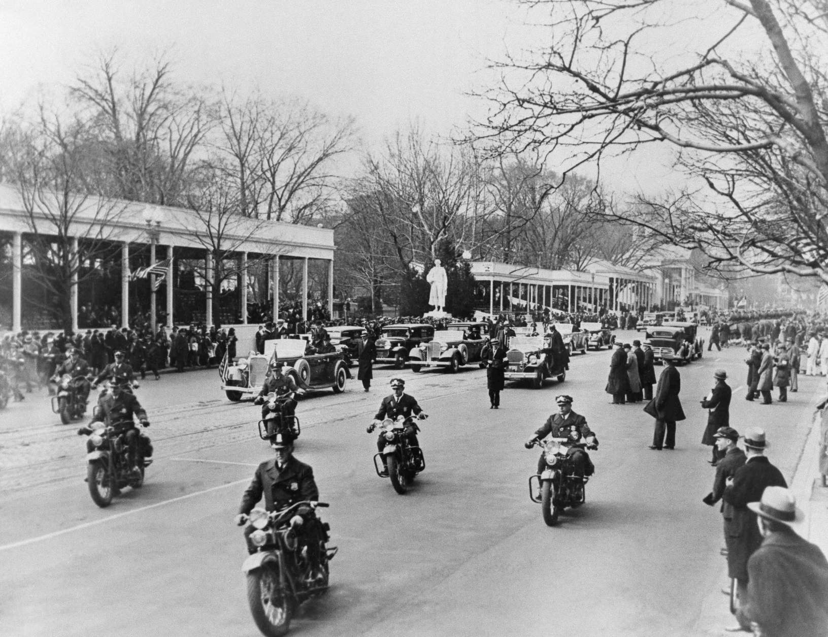 ** FILE ** In this March 4, 1933 file photo, motorcycle police escort the Presidential motorcade from the White House for the Capitol and the inauguration of Franklin D. Roosevelt in Washington.   Behind the cars is the court of honor from which two hours later Roosevelt as President reviewed the inaugural parade. (AP Photo/File)