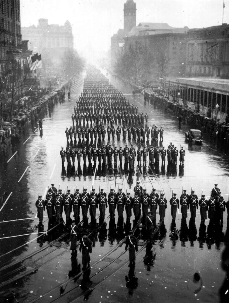FILE - Military units splash along in the pouring rain during the inaugural parade of President Franklin D. Roosevelt Jan. 20, 1937 in Washington.  Aides tried to talk  Roosevelt into moving the ceremony indoors but he looked out at the soggy crowd and replied: ``If they can take it, I can take it.''  Mother Nature doesn't always frown on presidential inaugurations, but occasional storms have been miserable, even fatal.  (AP Photo, files)