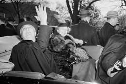 First lady Eleanor Roosevelt smiles President Franklin D. Roosevelt's side, as he waves a greeting to the crowd which cheered him as he left St. John's Church in Washington, Jan. 20, 1941, his third inaugural day. (AP Photo)