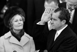 Richard Nixon holds his left hand on two family bibles and raises his right as he takes the oath as 37th President of the United States on the Capitol steps in Washington, D.C., Jan. 20, 1969. Behind his right hand is Vice President Spiro Agnew. Mrs. Pat Nixon holds the bibles. (AP Photo)