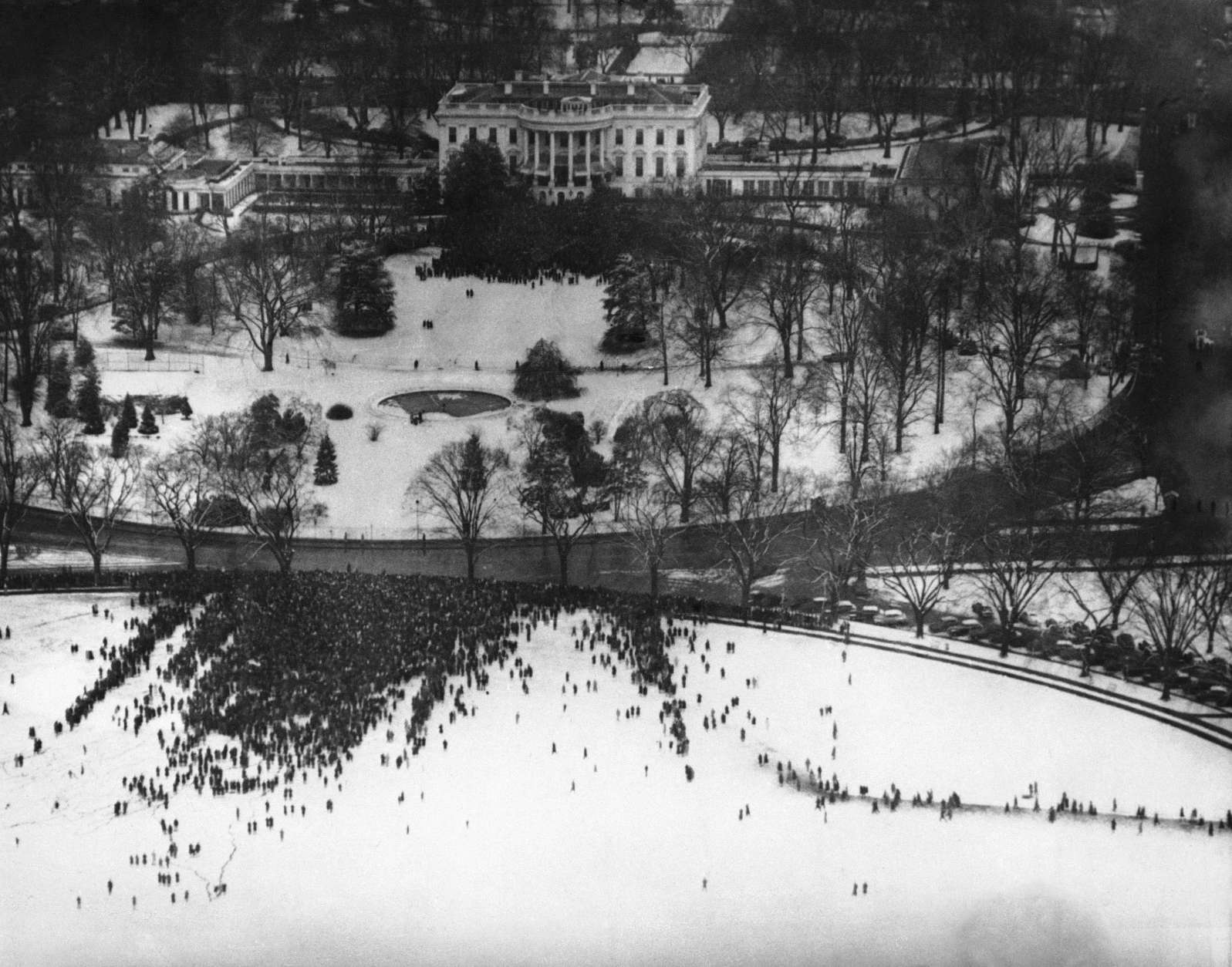 This birdseye view of President Roosevelt's unprecedented fourth term inaugural ceremony was made from the Washington Monument in Washington, D.C., Jan. 20, 1945. The crowd in the foreground is the general public gathered on the ellipse. In the background is the White House, with the crowd of invited guests gathered around the South Portico. (AP Photo)