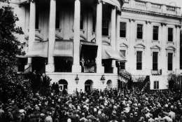 Over 7,000 people stood in the snow-covered grounds at the back of the White House to watch President Roosevelt inaugurated in Washington, on Jan. 20, 1945, for his fourth term. Wartime Austerity was the keynote of the proceedings and the whole ceremony was completed in under 15 minutes. President Roosevelt takes the oath, as diplomats, members of Congress and distinguished guests look on in foreground. On the porch are cabinet members, Supreme Court justices and their wives. Prominent in centre of porch are, left to right: Edwin Halsey, Secretary of Senate, two unidentified secret servicemen; President Roosevelt, and his son, Colonel James Roosevelt. (AP Photo)