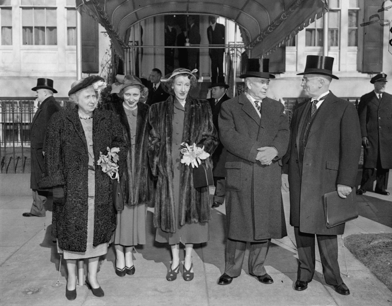 Leaving Blair House for inauguration oath-taking at the Capitol, January 20, 1949, are left to right:  Mrs. Truman; Margaret, daughter of the President; Mrs. Max Truitt, daughter of Vice-President Barkley; Vice-President Alben Barkley, and President Truman. (AP Photo/stf)
