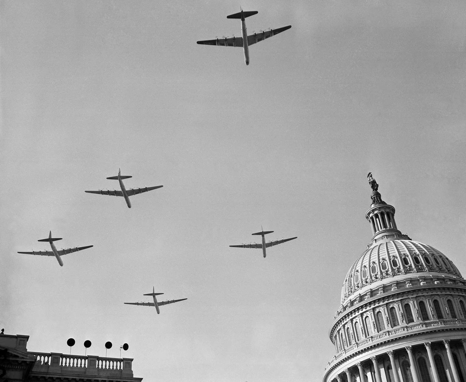 Giant B-36 planes of the U.S. Air Force join the inaugural parade in a flight over the Capitol dome in Washington, Jan. 20, 1949. (AP Photo)