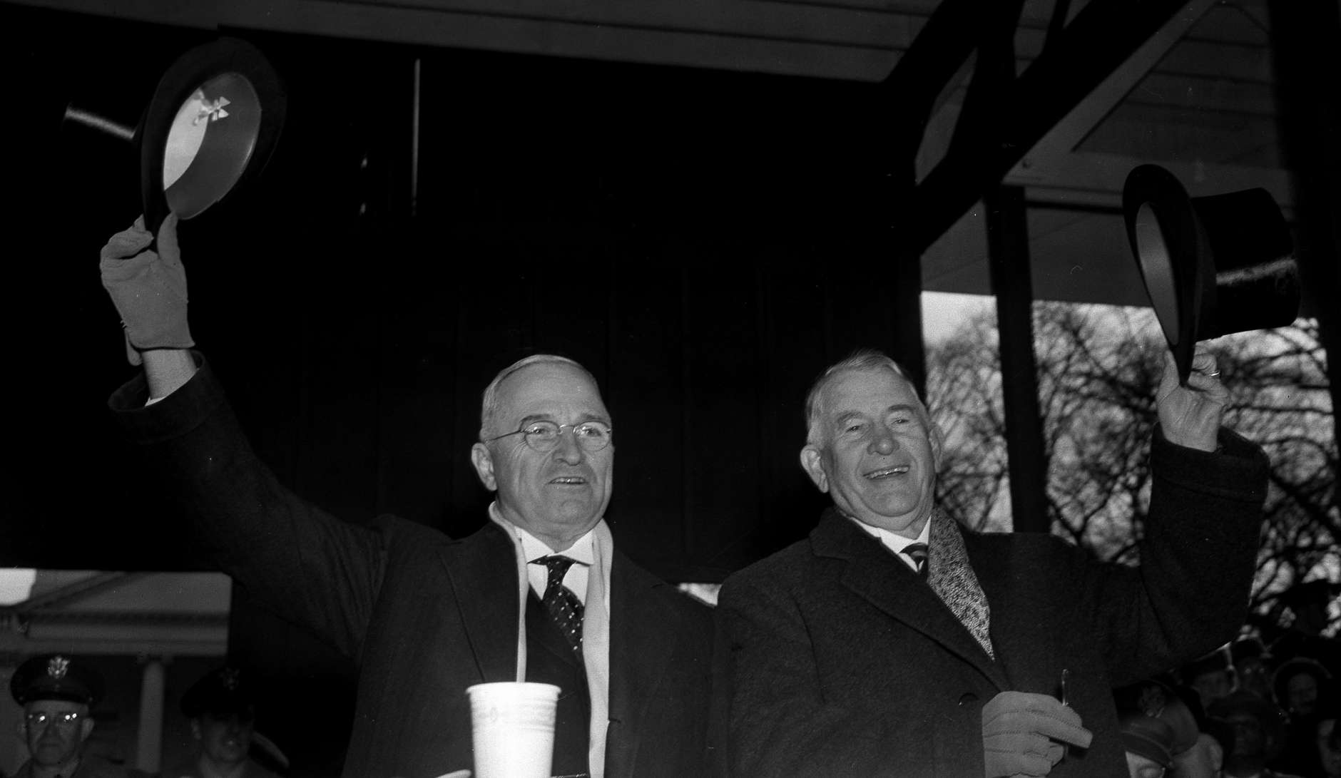 U.S. President Harry S. Truman, left, and Vice President Alben W. Barkley wave from the inaugural parade reviewing stand in front of the White House after their inauguration in Washington, D.C., Jan. 20, 1949.  (AP Photo)