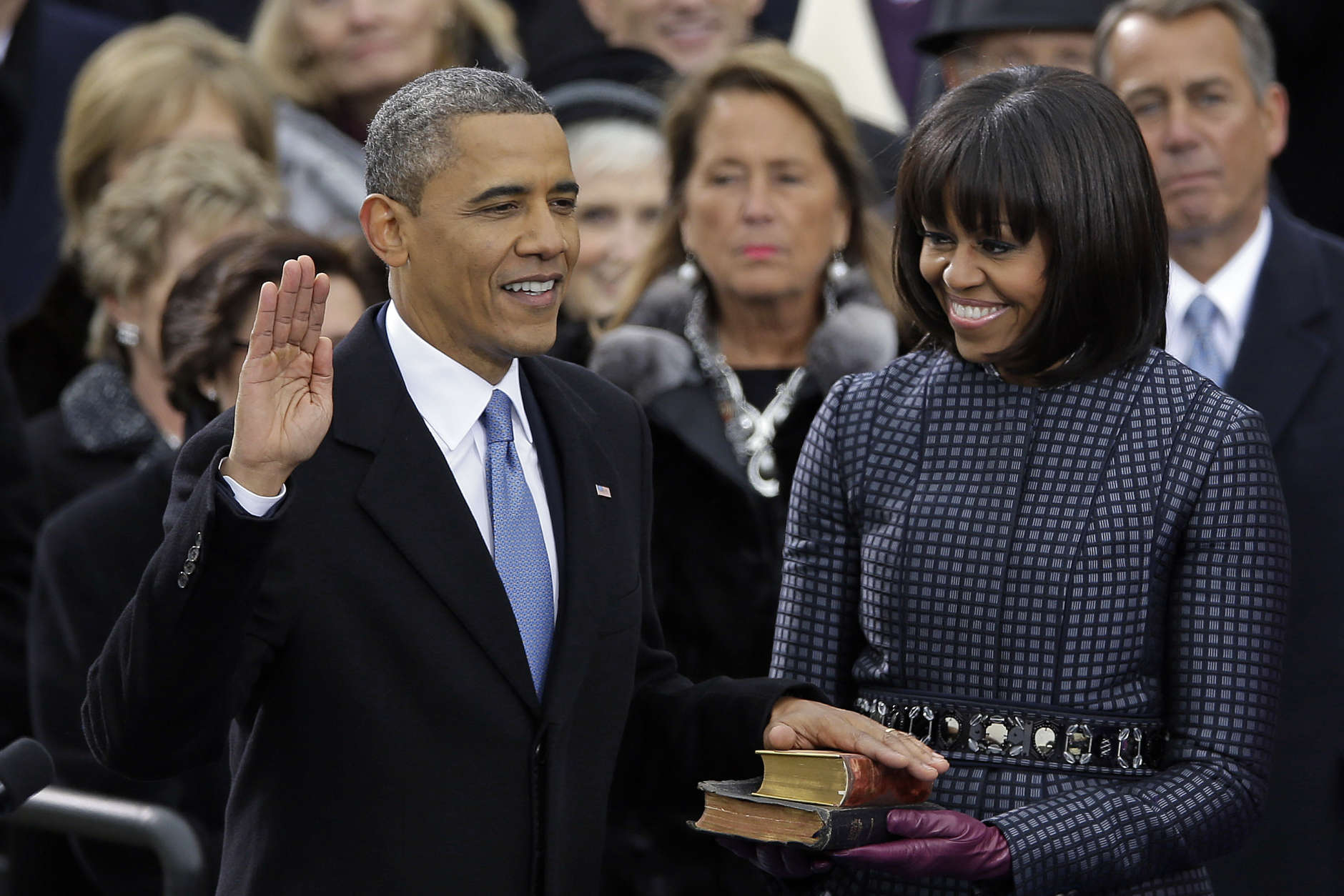 RETRANSMITTED TO REMOVE REFERENCE TO DAUGHTERS, WHO ARE NOT PICTURED- President Barack Obama receives the oath of office from Chief Justice John Roberts as first lady Michelle Obama watches during the ceremonial swearing-in at the U.S. Capitol during the 57th Presidential Inauguration in Washington, Monday, Jan. 21, 2013. (AP Photo/Carolyn Kaster)