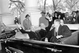 With smiles and a wave, U.S. President Harry Truman, left, and his successor, president-elect Dwight D. Eisenhower, leave the White House in an open car for inauguration ceremonies in Washington, D.C. on Jan. 20, 1953.  Sitting in the front is Sen. Styles Bridges of New Hampshire, and behind him is House Speaker Joe Martin.  (AP Photo)