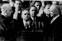 Dwight Eisenhower takes the oath of office January 20, 1953 as president of the United States. The oath is administered by Chief Justice Fred Vinson, left. Supreme Court Clerk Harold B. Willey is at center. (AP Photo)
