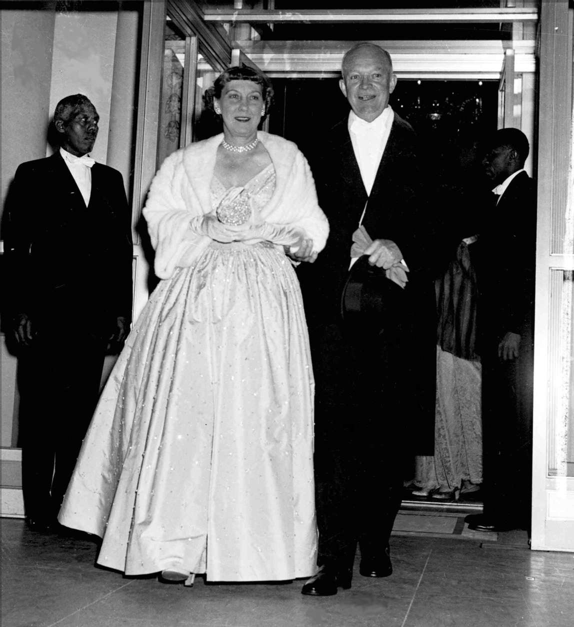 President Dwight Eisenhower holds the arm of his wife, first lady Mamie, as they leave the White House en route to inaugural balls in Washington January 20, 1953. (AP Photo)