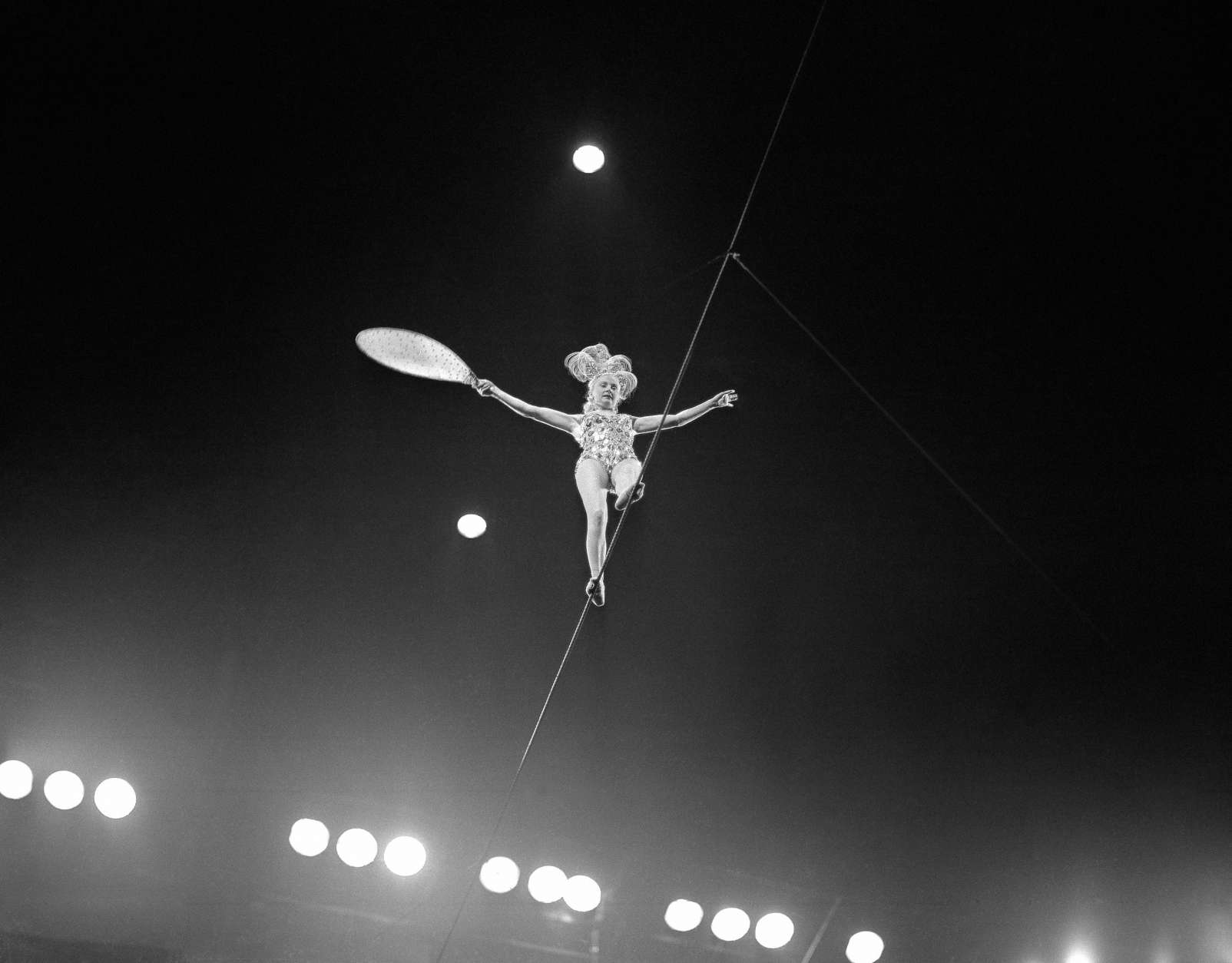 A woman walks a tightrope at the circus in 1955